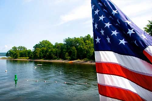The flag flies over Burton Island State Park (photo credit: Amy Chess)