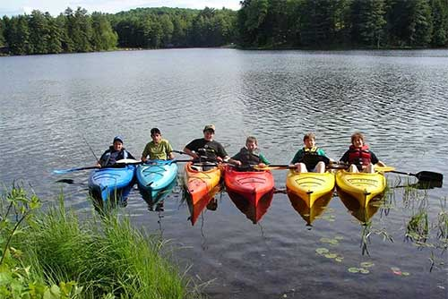 A rainbow of kayaks at Half Moon Pond State Park (photo credit: Lisa Ann Munukka Frasier)