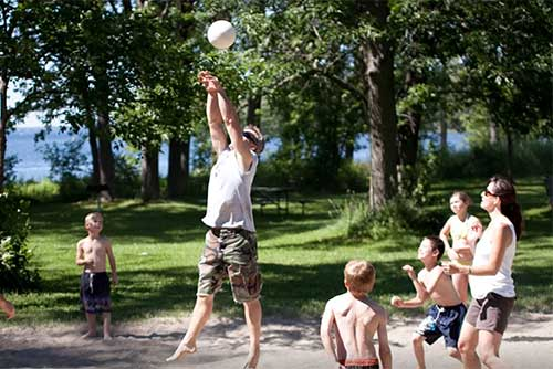 A friendly volleyball game at Kamp Kill Kare State Park