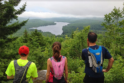 Vermont State Park Trail Runners look out over Kettle Pond