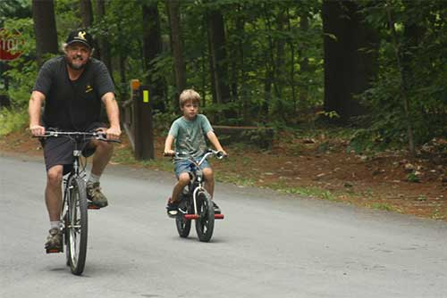 Family biking at Quechee State Park (photo credit: Lindsey Pokorak)