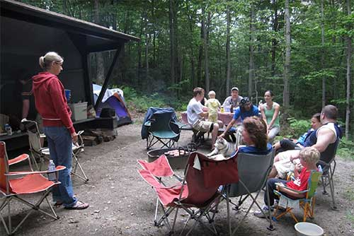 Family lean-to camping at Smugglers' Notch State Park